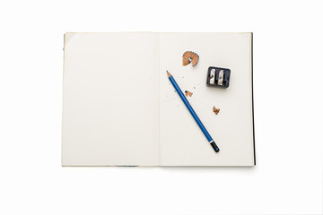 open blank diary with pencil, sharpener and pencil shavings, iso