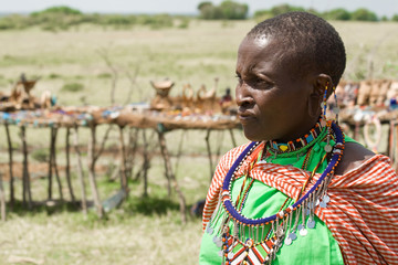 Portrait of Masai woman in the background souvenir stalls