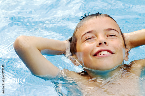 boy relaxing at swimming-pool