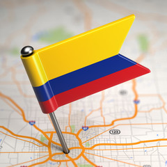 Colombia Small Flag on a Map Background.