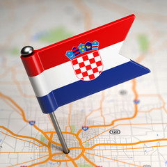 Croatia Small Flag on a Map Background.
