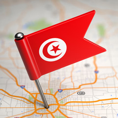 Tunisia Small Flag on a Map Background.