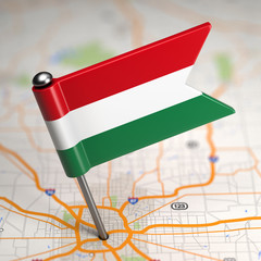 Hungary Small Flag on a Map Background.