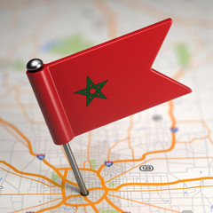 Morocco Small Flag on a Map Background.