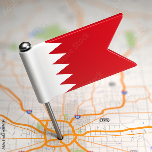 Bahrain Small Flag on a Map Background.