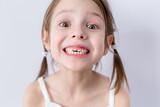 Close up portrait of preschooler girl with wide smile