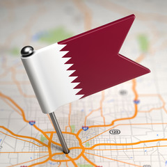 Qatar Small Flag on a Map Background.