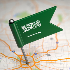 Saudi Arabia Small Flag on a Map Background.