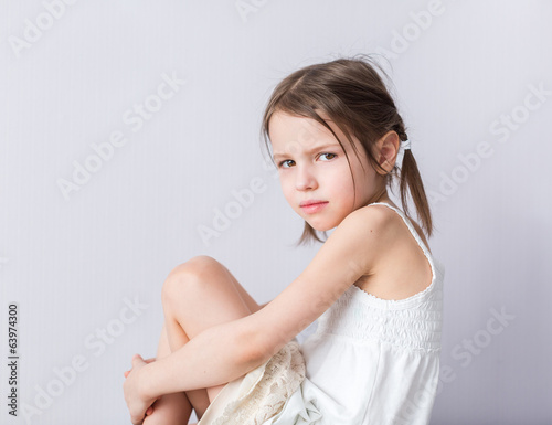 Portrait of angry preschooler girl in closed pose
