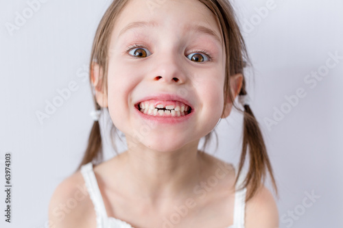 Close up portrait of preschooler girl with wide smile
