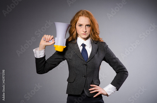 Woman with loudspeaker in studio