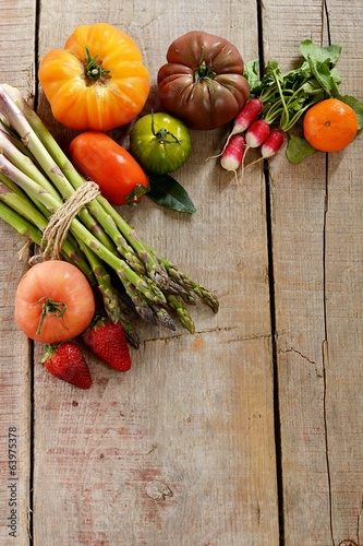 Vegetables on wooden background. Copyspace above