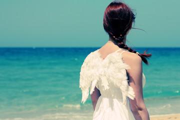 Angel ethnic woman near the sea