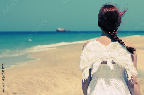 Angel ethnic woman near the sea