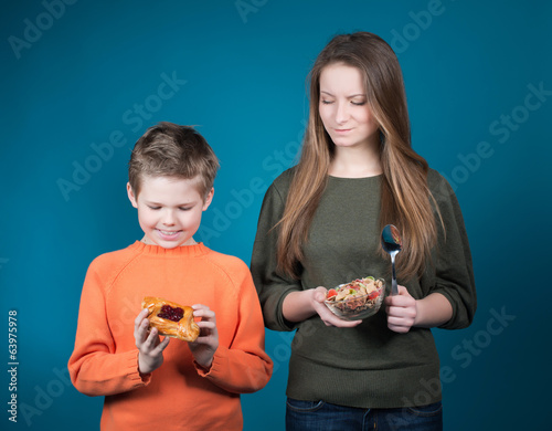 Young woman hesitating between cereal or pastry. Diet.