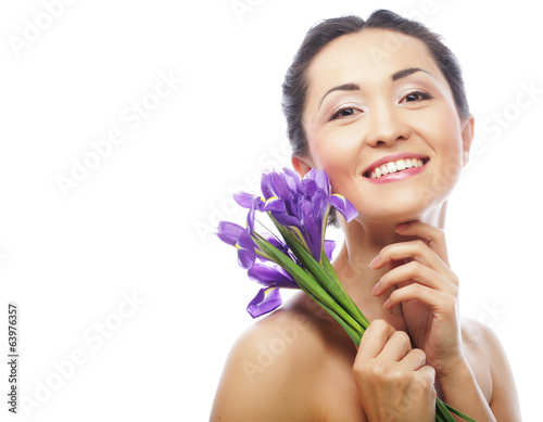 young asian model with iris flowers.