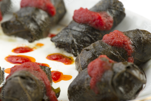 Close up of traditional food dolma on a white plate