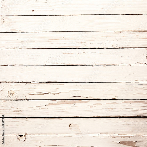 White wooden boards with peeling paint