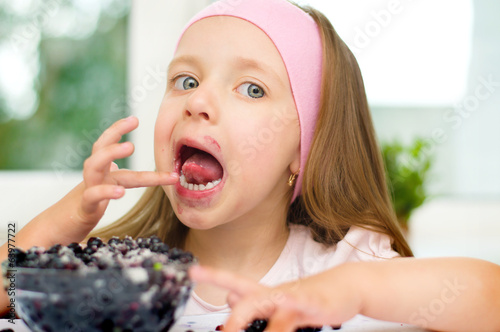 kid with berries