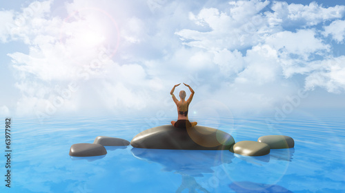 Female in yoga position in ocean