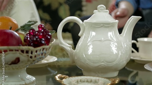 Antique elegant tea set on the table (close-up)