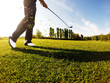 Golfer performs a golf shot from the fairway. - 63979782