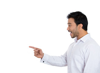 Smiling, laughing man pointing finger at someone on white