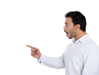 Side view shocked young man pointing finger at someone
