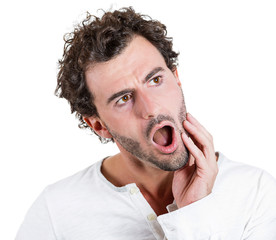 Young man having bad toothache, sensitive teeth