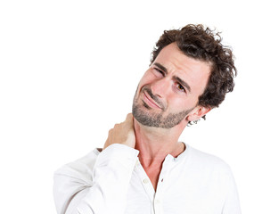 Neck pain, annoyed, stressed young man