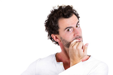 Anxious, scared young man nervously biting fingernails