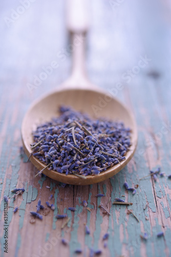 Lavender flowers in a bamboo spoon