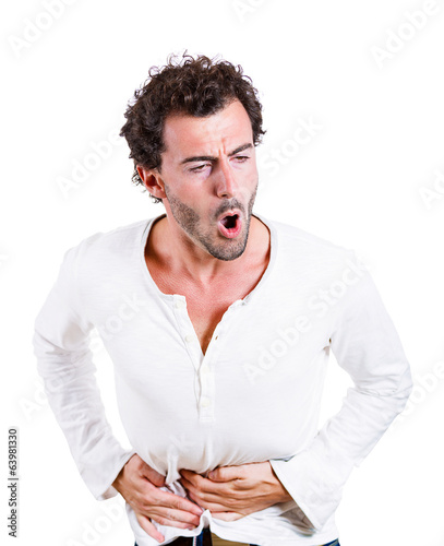 Young man having severe abdominal, stomach pain