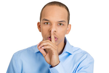 Shhh. Young business man asking to be quiet