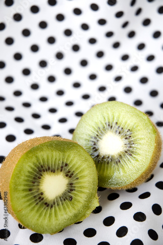 sliced kiwi fruit on polka dots