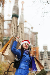 Smiling girl with purchases in Barcelona