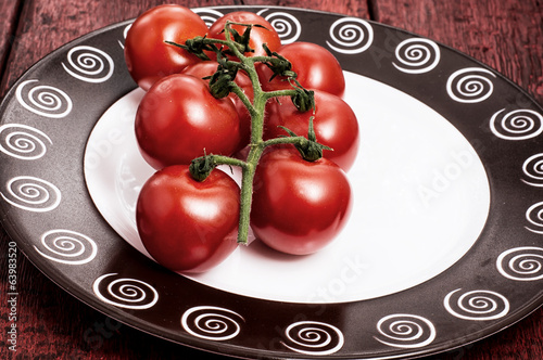 tomatoes on branches