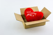 Red heart in brown box.