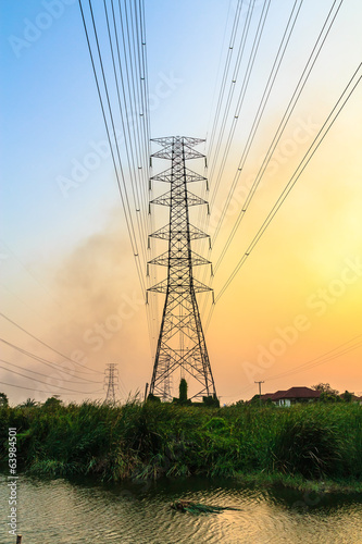 High voltage power lines at sunset.