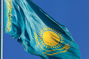 Kazakhstan flag on a blue background