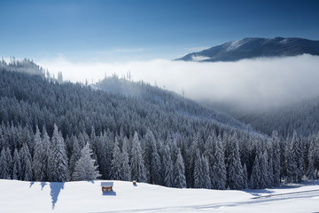 Winter mountain landscape with blue sky and white clouds
