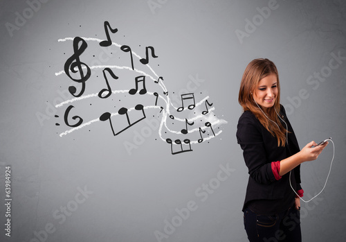 attractive young lady singing and listening to music with musica