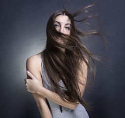 portrait of a beautiful woman with flying hair.