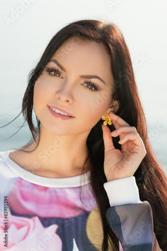 young and beautiful woman  in sunset light