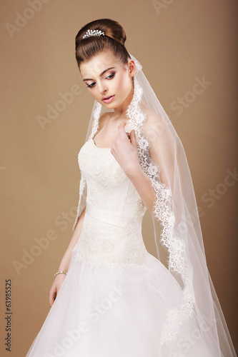 Femininity. Sentimental Bride in White Dress and Openwork Veil