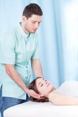 Chiropractor doing neck adjustments