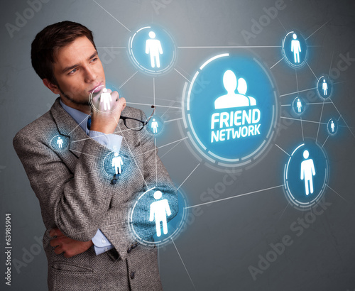 Handsome man looking at modern social network
