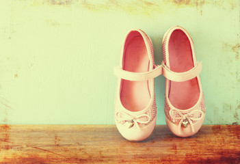 girl shoes over wooden deck floor