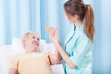 Elderly women having arm examination