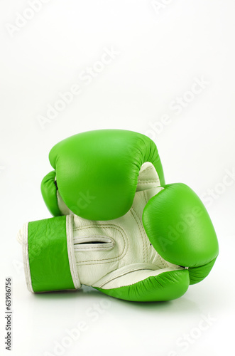 Green boxing glove on white background
